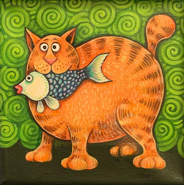 A fat orange cat with a fish