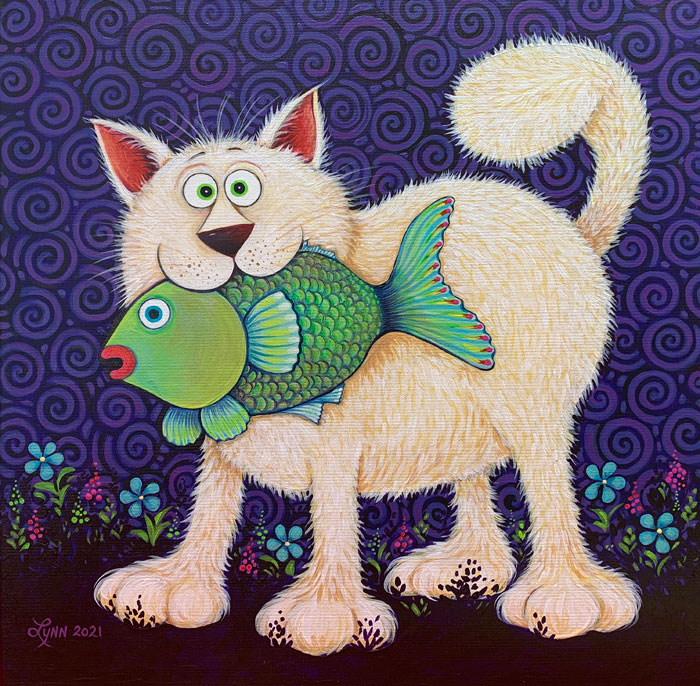 A white cat holds a fish in its mouth