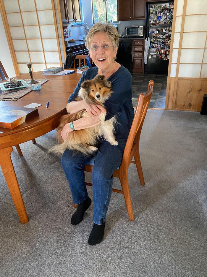 Lynn cuddling Keira, her portrait subject